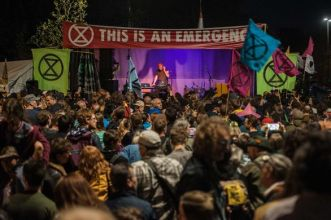 https---socialistworker.co.uk-images1412-Image-gallery-Guy-Extinction-rebellion-20-21-22-April-extinction-rebellion-massive-attack-3d-dj