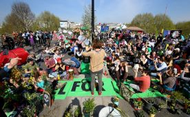 Extinction Rebellion demonstrators hold a community meeting on Waterloo Bridge in London. (Photo by Gareth Fuller/PA Images via Getty Images)